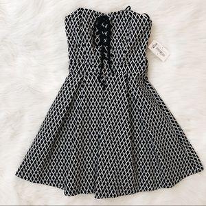 B. Darlin Lace Up Black & White Dress